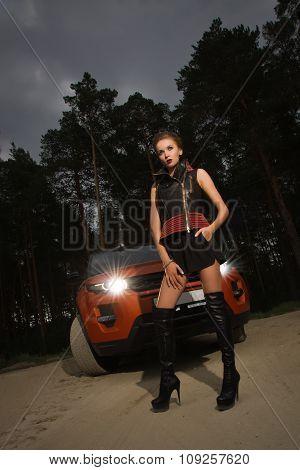 Cheerful Fashion Woman Standing Near Vehicle