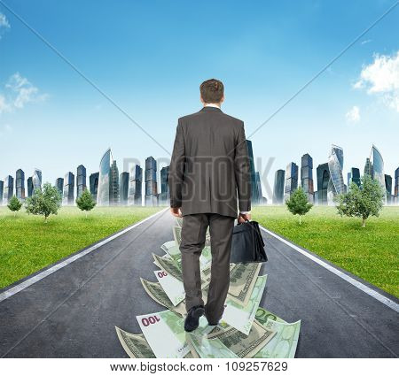 Man walking on money road