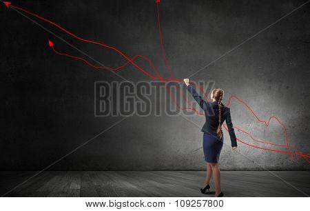 Young businesswoman catch with hand growing graph arrow