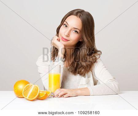 Young Brunette Woman Having Orange Juice.