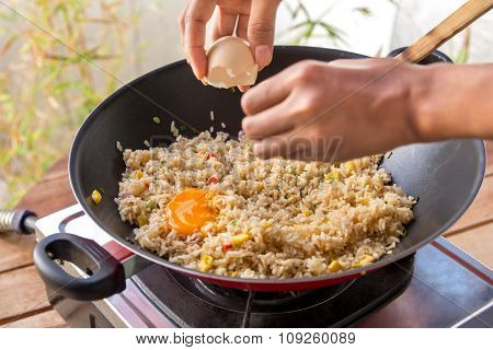 Human Hands Adding Egg Into Fried Rice