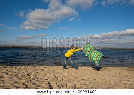 Joyful  Woman Having Fun, She Is Surprised, Playing With A Coverlet In The Wind, In The Beach