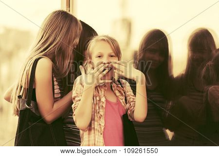 Group of teen girls looking through the mall window