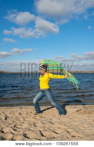 Expressive Joyful  Woman Happily Goes To Meet The Wind,  Having Fun, Playing With A Veil In The Wind