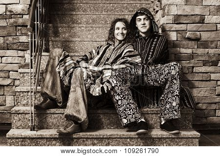 Young fashion couple sitting on the steps