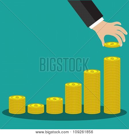 Buisness man hand hold gold coin and stacks