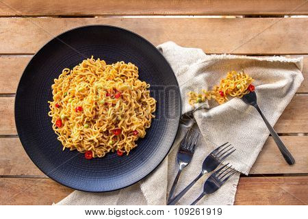 Spicy Indonesian Fried Noodle With Fork And Napkin