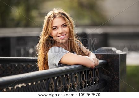 Happy young fashion woman on the city street