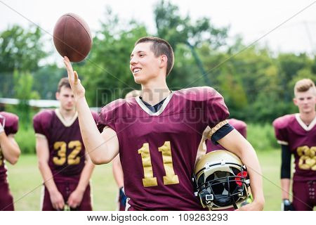 American Football player showing trick with ball