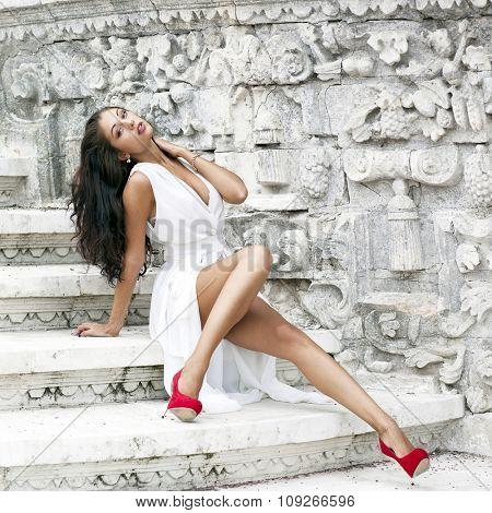 Sexy woman in white long dress
