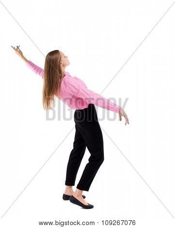 Balancing young business woman.  or dodge falling woman. Rear view people collection.  Isolated over white background. Woman office worker in a pink shirt falls on his back waving his arms.