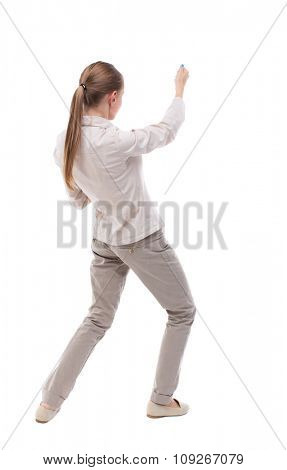 back view of standing girl pulling rope from top or cling to something. girl  watching. Isolated over white. Girl with long hair in a white jacket top right pulls the rope. Strongly otklanyayas ago.