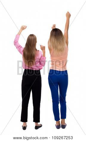 Back view of two young  women dancing.  Rear view people collection.  backside view of person.  Isolated over white background. Two girls blonde waving their arms.