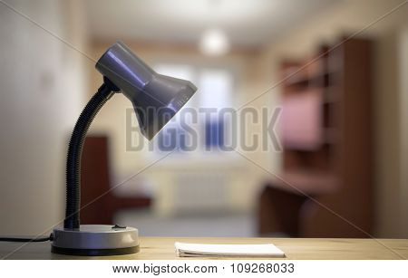 lamp and notebook on table in the living room