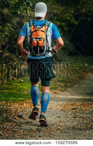 young man runs through Park