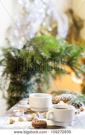 Coffee, tangerines, cookies and nuts in Christmas decor on colorful background bokeh