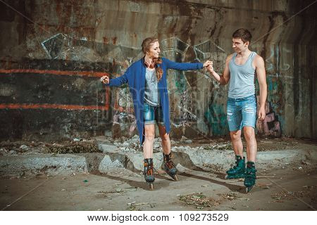 young roller couple on graffiti background