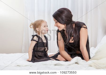 Happy Mother and daughter in bed