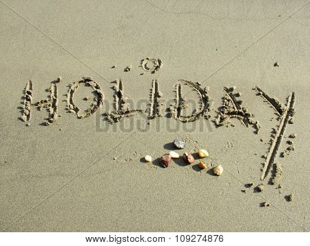 Holiday Word on the sandy beach. Travel concept
