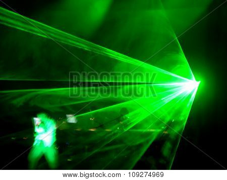 Concert dj performance with green laser effects