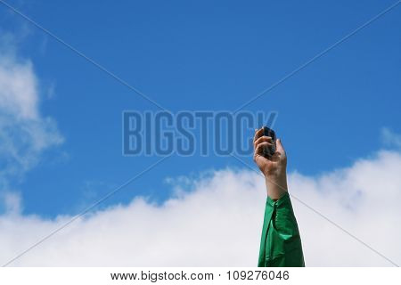 A mobile / Cell phone concept. Woman arm holding a mobile phone
