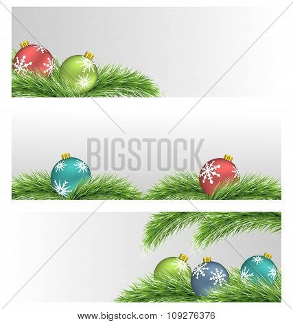 Christmas balls on pine branches