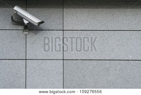 Security Camera on the wall. Surveillance concept