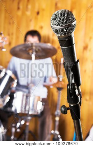 Drummer play rock drums and microphone in focus. Rock music concept