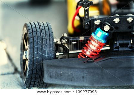 Detail shot of an automobile wheel and open engine. Car tuning concept