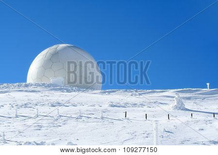 Weather station, high on a mountain top under snow. Meteorology concept