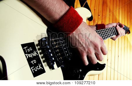 Guitarist play rock guitar. White electric guitar