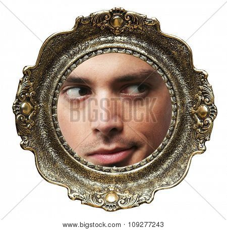 Round picture frame with a man face.  Straight face expression in picture frame