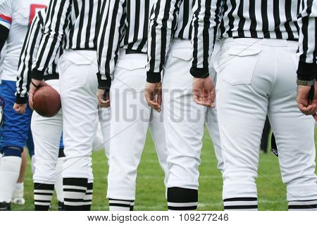 American football referee holding ball. American football concept