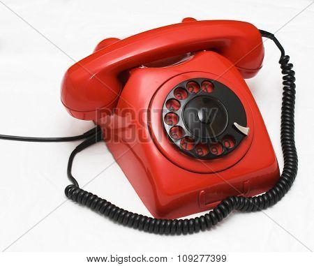 Used old retro red phone. Retro industrial design telephone