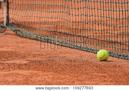 Detail of clay tennis court. Tennis ball and net