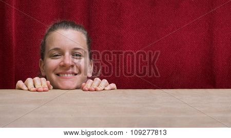 Smiling woman with head on hands. Happiness concept
