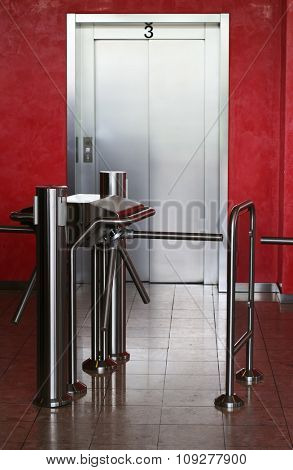 Modern building elevator with security check point in front