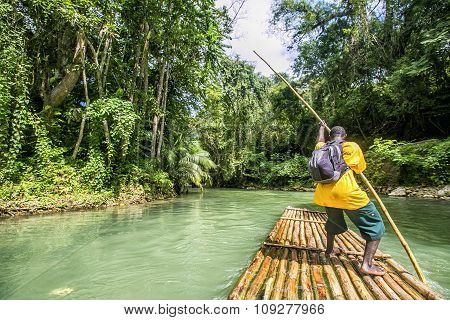Bamboo Rafting On The Martha Brae River In Jamaica.