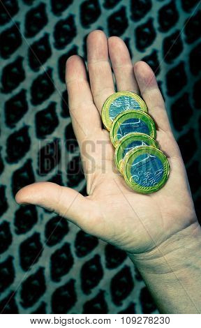 One euro coin money in hands. Business and economy concept