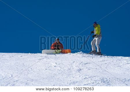 Snowboard and ski friends on snow. Winter sport lifestyle concept