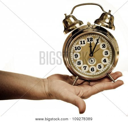 Retro clock in hand. Deadline miss and time  management concept