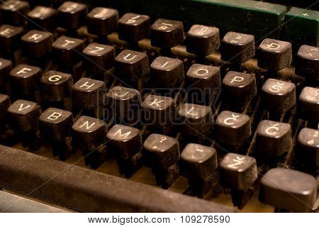 Isolated old dusty typewriter keyboard. author and copyright concept