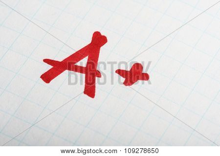 School exam grade A+ mark on paper