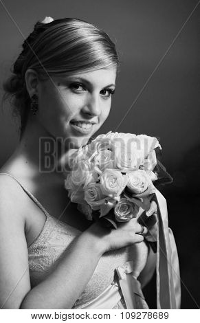 Beautiful the bride portrait with bouquet flowers. Soft dreamy look, sharp eyes and face