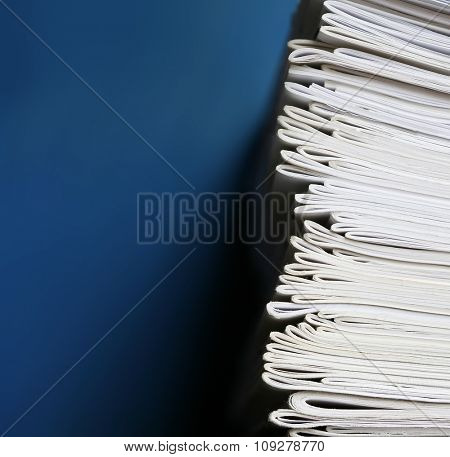 Stack of notebooks isolated on blue background. Education and school concept