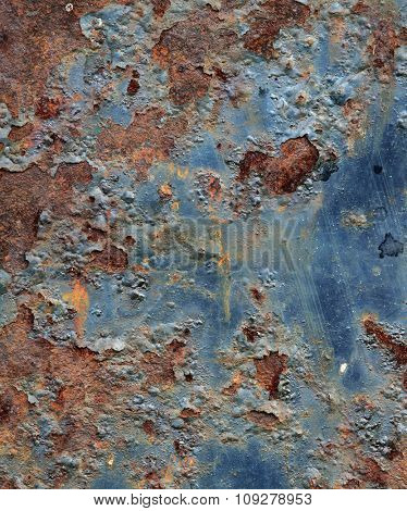 Cracked paint on an old metal surface. Grunge rusty metal texture