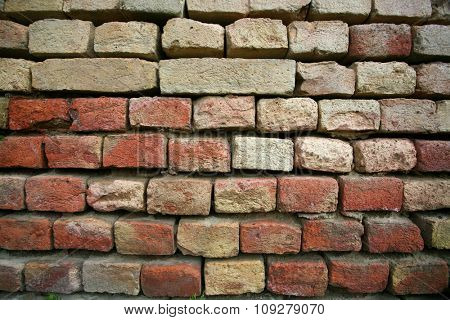 Old brick wall texture in high resolution and detail  shot with wide angle lens