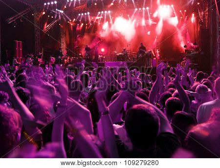 Band at rock music concert. Blur crowd motion