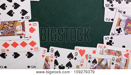 Casino cards on a green background form a frame