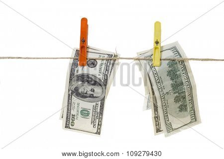 Hundred dollar bills hanging on rope isolated over white background. Money laundering concept